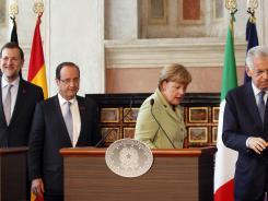 From left, Spanish Premier Mariano Rajoy, French President Francois Hollande, German Chancellor Angela Merkel and Italian Premier Mario Monti leave a joint news conference in Rome, June 22, 2012.
