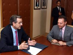 Greece's Prime Minister Antonis Samaras, left, meets with his finance minister, Yannis Stournaras, in Athens, Aug. 8, 2012.