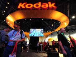 People visit the Kodak display at the International Consumer Electronics Show (CES) in Las Vegas, Jan. 11, 2012.