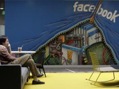 A worker in the Facebook office in Menlo Park, Calif. Facebook shares are down 44% from it's initial public offering price.