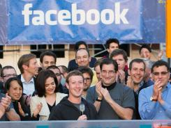 Facebook CEO Mark Zuckerberg, center, rings the Nasdaq opening bell from Facebook headquarters in Menlo Park, Calif., on May 18, 2012.