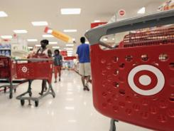 Customers fill the aisles at a Target store in Chicago on July 5, 2012.