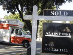 A moving truck is shown at a house June 19, 2012, that was sold in Palo Alto, Calif.