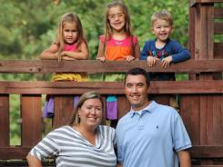 Family finances: Kim and Chris Knox, with their three children: Addison, left, Emily and Cameron. Kim started learning about investing when Chris helped his mother through a divorce.