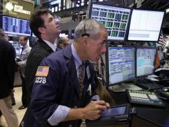 Traders on the floor of the New York Stock Exchange Aug. 15, 2012.