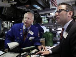 Trading specialists att their post on the floor of the New York Stock Exchange on Aug. 15, 2012.