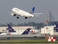 A passenger jet takes off at Newark Liberty International.