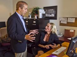 Joshua Simon of the S/I real estate firm in Scottsdale, Ariz., speaks with mom Nikki Simon, an office employee.