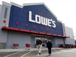 Customers walk toward the Lowe's store in Saugus, Mass.
