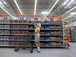 Thelma Stadtfeld shops in the toy department of the Wal-Mart store in Pompano Beach, Fla.