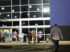 Customers enter a Best Buy store in Manassas, Va.