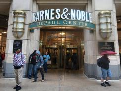 People walk by the entrance to a Barnes & Noble store on April 30, 2012, in Chicago.