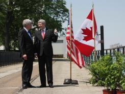 Canadian Prime Minister Stephen Harper and Michigan Gov. Rick Snyder on June 15 in Windsor, Canada, for an announcement of a new bridge connecting the city with Detroit.