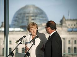 German Chancellor Angela Merkel and French President Francois Hollande speak to the media at the Chancellery on Aug. 23 in Berlin, Germany.