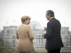 German Government German Chancellor Angela Merkel talks with Prime Minister of Greece Antonis Samaras, right, on the terrace of the federal chancellery in Berlin, Aug. 24, 2012.