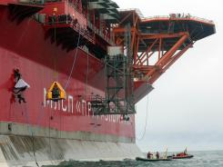A photo taken by Greenpeace Aug. 24, 2012 shows activists boarding the Arctic oil platform somewhere off Russia's north-eastern coast in the Pechora Sea.