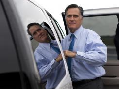 Republican presidential candidate, former Massachusetts Gov. Mitt Romney gets into his car to attend a fundraising event on Aug. 18, 2012 in Nantucket, Mass.