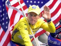 Lance Armstrong rides down the Champs Elysees in Paris in 2000 after his first-place finish in the Tour de France.