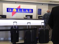 Customers on line at a Dollar rental car counter at San Jose International Airport in San Jose, Calif.