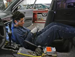 Student Josue Mattin Del Campo works on a Nissan Altima at Los Angeles Trade-Technical College.