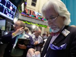 Trader Dan Tandy works on the floor of the New York Stock Exchange in August 2012.