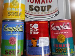 New limited edition Campbell's tomato soup cans with art and sayings by artist Andy Warhol will be sold at Target stores Sept. 2, 2012.