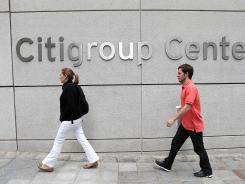 Pedestrians walk by the Citigroup Center on July 16, 2012, in San Francisco.