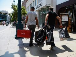 Shoppers walk down the Third Street Promenade outdoor shopping mall Aug. 17, 2012 in Santa Monica, Calif.