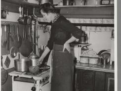 "Inside image from ""Dearie: The Remarkable Life of Julia Child"" by Bob Spitz, of 'In the kitchen at Roo de Loo, Paris: 1950.'"