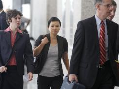 Hanjuan Jin, center, leaves the federal courthouse in Chicago on Wednesday.