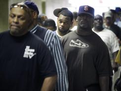 Job seekers wait in line at a construction job fair in New York in August 2012.