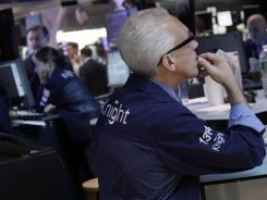 Knight Capital trading specialist David Pologruto at work on the floor of the New York Stock Exchange in August 2012.