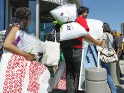 Stocking up: Shoppers carry their purchases at a Target in Chicago.