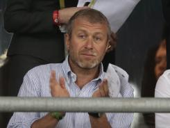 Roman Abramovich, owner of the Chelsea soccer team in Britain, applauds during the Euro 2012 championship quarterfinal in Kiev, Ukraine.