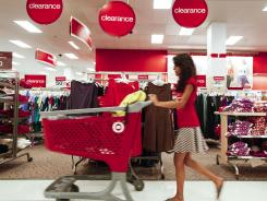 A shopper pushes a cart through the clearance section of a store in Chicago on Aug. 22.