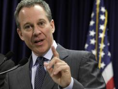 New York Attorney General Eric Schneiderman answers a a question during a news conference in March 2011.