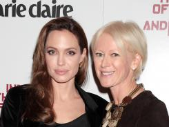 "Joanna Coles, right, was named editor of Cosmopolitan magazine's U.S. edition Sept. 4, 2012. Here Coles poses with actress Angelina Jolie at a screening of her film, ""In The Land of Blood and Honey"" in December."
