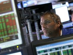A trader works on the floor of the New York Stock Exchange in New York, on the last day of August 2012.