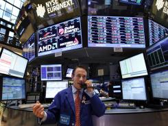 A trader works on the floor of the New York Stock Exchange, in New York, in August 2012.
