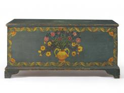 For tucking away the woolies: A decorated pine blanket chest from about 1820-1825.