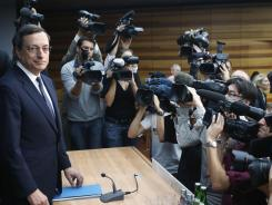 Mario Draghi, president of the European Central Bank, is surrounded by media at the beginning of a news conference in Frankfurt, Germany, Sept. 6, 2012.