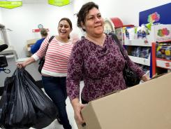 Better to give: Yoneira Noriega, left, and her mother, Anna Noriega, leave the Kmart layaway department with their gifts on Dec. 19, 2011.