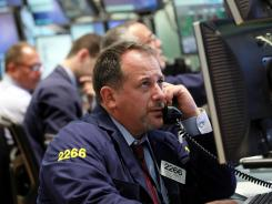 Broker Paul Mandile works the trading floor of the New York Stock Exchange on Thursday.