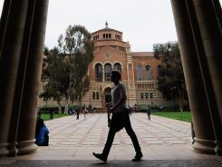 A student walks near Royce Hall on the campus of UCLA in Los Angeles.