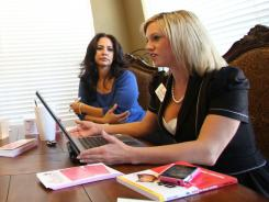 Amber Rodgers, right, conducts a business meeting for D.I.V.A.S. (Divorcing Independent Very Able Survivors), the company she founded a year after her divorce. D.I.V.A.S. provides legal, financial and real-estate help.