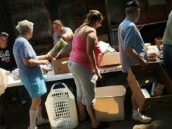 People attend a food distribution by the Food Bank of the Southern Tier Mobile Food Pantry on June 20 in Oswego, N.Y. An estimated 15% of Americans lived in poverty last year.