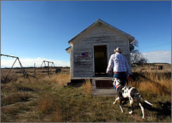 79-year-old rancher Bill Pinkerton enters the one room Beaver Creek Schoolhouse in rural Treasure County Montana to vote in Missoula, Mont. Beaver Creek Schoolhouse was a school until the 1960's. Now it is a polling place.