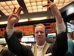 A trader signals an offer in the 10- and 20-year Treasury note options pit at the CME Group on Dec. 14, 2010, in Chicago, Ill.