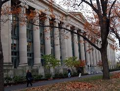 Students walk past Harvard Law School on the campus of Harvard University in Cambridge, Mass.