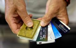 A Florida consumer displays his credit cards.